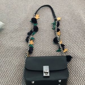 Zara navy blue small shoulder strap bag.